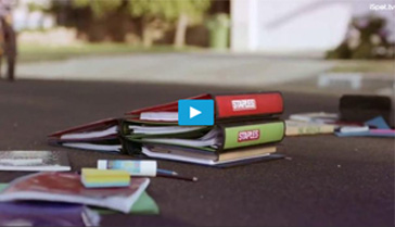 Staples ad showing notebooks in the street