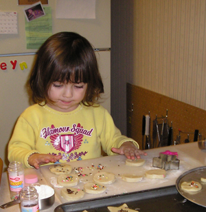 Three-year-old baking cookies